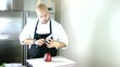 Chef testing the knife in the kitchen. Timelapse