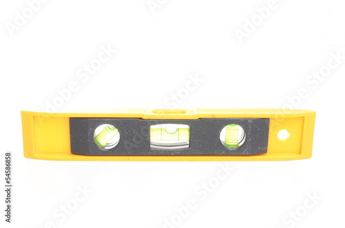 Yellow spirit level isolated on white