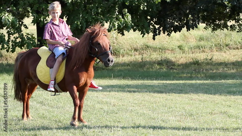 boy riding pony horse