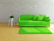 Green sofa near the wall