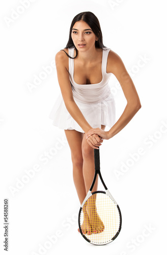 Young tennis player isolated over white