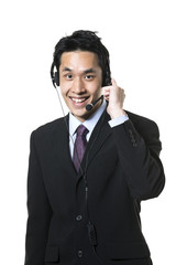 Asian call-center agent wearing a headset.