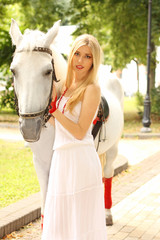 Beautiful lady with white horse