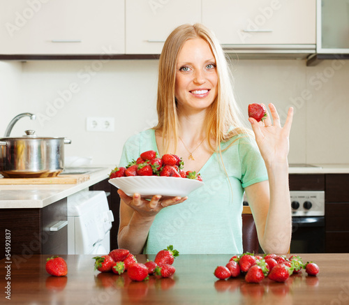 long-haired girl with strawberries