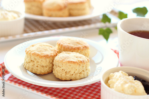 Home-baked scones with clotted cream, blackcurrant jam and tea
