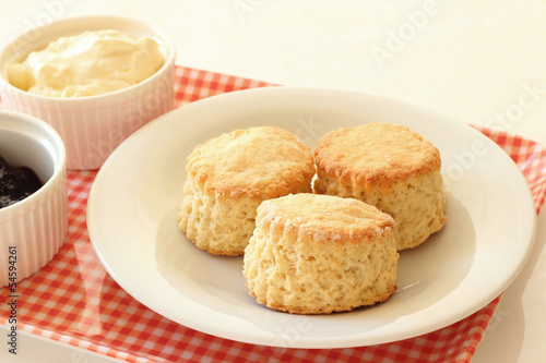 Home-baked scones with clotted ceam and blackcurrant jam