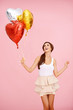 Cute brunette with balloons
