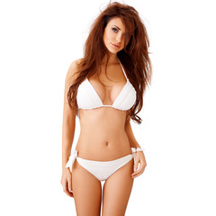 Sexy young brunette in a white bikini