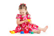 child girl playing with cup toys, isolated over white