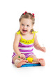 cheerful baby girl playing with musical toy