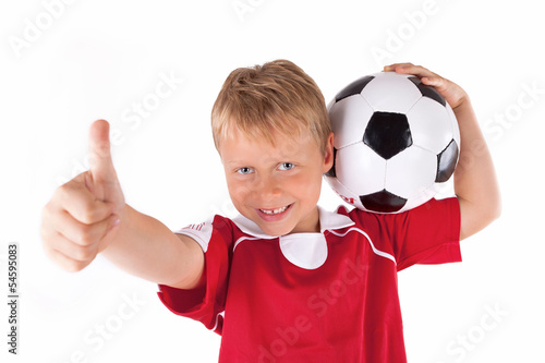 canvas print picture Junge mit Fußball lachend