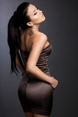 beautiful fashionable woman in brown dress