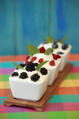Summer delights - fresh seasonal fruits with yogurt
