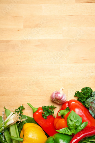Healthy Organic Vegetables on a Wooden Background. Art Border De