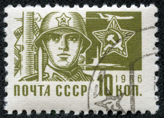 stamp printed in Russia showing a Soldier and star emblem