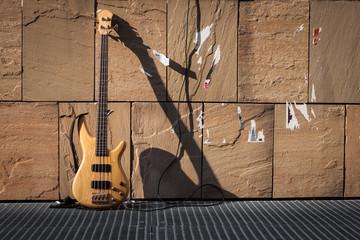 Bass guitar against a wall