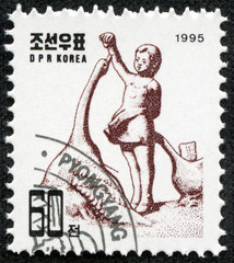 stamp shows a Sculpture of Children Girl with goose