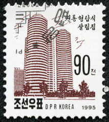 stamp printed in North Korea shows a Tower apartment block