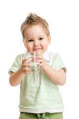 Funny kid drinking water from glass on white