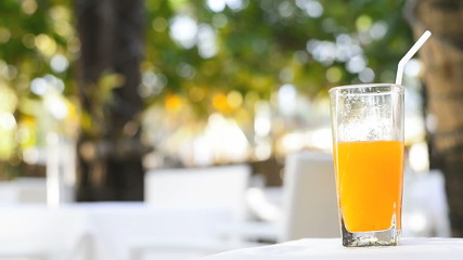 Glass of orange juice stock footage