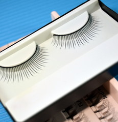 Black colored false eyelashes, close up