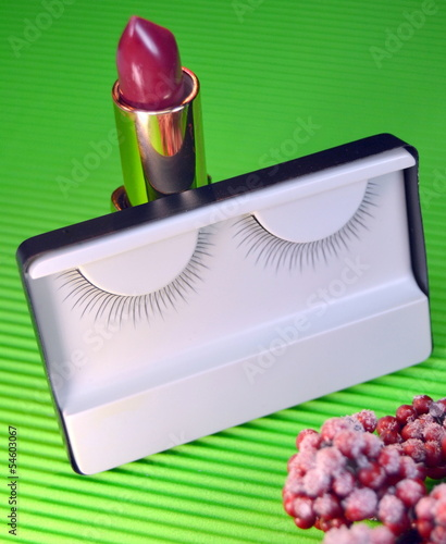 Black colored eyelash and lipstick, close up