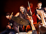 Band playing musical  instrument.