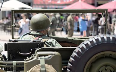 Military driving a car
