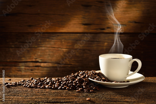 Poster, Tablou Coffee cup and coffee beans on old wooden background