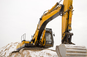 excavator quarry sand pit snow winter industry