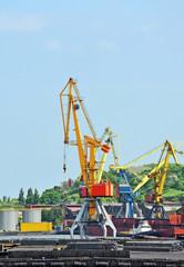 Pipe stack, ship ans train under crane bridge