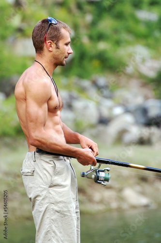Brawny and muscular fisherman with a naked torso