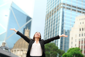 Business woman happy success outdoor in Hong Kong