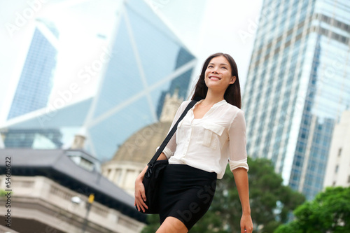 Asian Business woman walking outside in Hong Kong