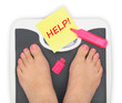 Woman' s feet on bathroom scale - 54606607