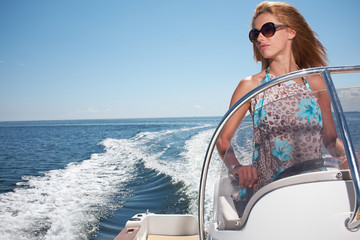 Woman  in Dress Driving A Speedboat Fast At Sea