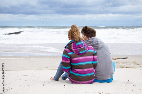 happy pair of male and female embracing and having fun wearing w