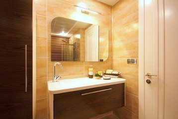 A modern brown bathroom
