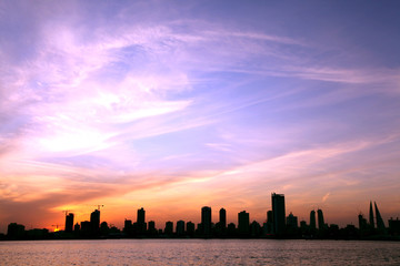 Stretching sea and Bahrain skyline at beautiful sunset