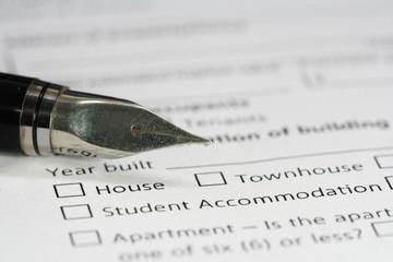 pen on housing document paper
