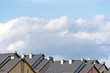 Row house roofs, condo rooftop panorama, summer sky