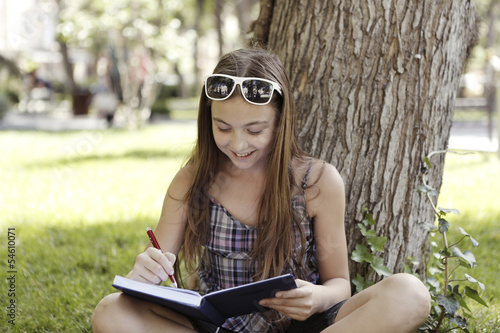 Girl writes something in notebook