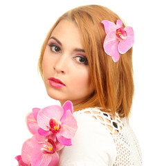 portrait of sexy young woman with pink orchid flower