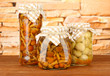 Delicious marinated mushrooms in glass jars,