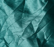 crumpled green fabric background