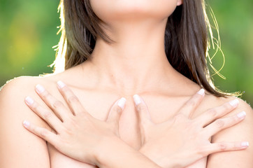 close up, topless woman body covering her breast with hand,