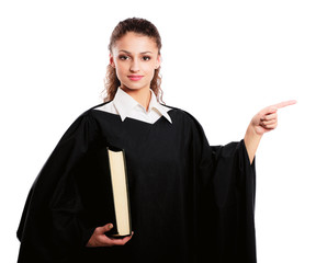 Portrait of a  female judge holding law book and pointing