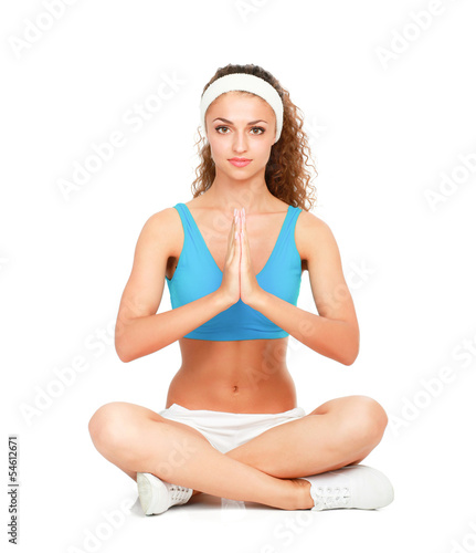 Young lady practising yoga indoors. Isolated on white background