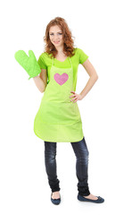 Young woman wearing kitchen apron with cooking mittens,