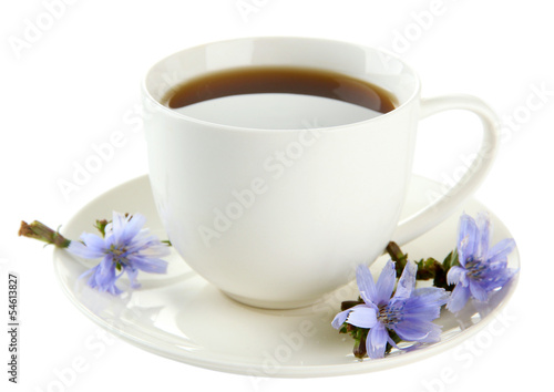 Cup of tea with chicory, isolated on white